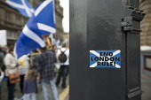 A sticker on a lamp post proclaiming End London Rule as crowds march down North Bridge in Edinburgh during the pro-Independence march and rally. The event, which was staged in support of the pro-Indep... Colin McPherson / Scottish Viewp 2013,SNP,Salmond,Scots,Scotsman,Scottish,National,Party,Scottishness,UK,United,Kingdom,devolution,kilt,kilts,men,movements,nationalism,politian,politicians,politics,tartan,vote,voters,voting,capital,s