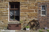 A detail of a quaint terraced cottage, Stromness, Mainland, Orkney. Scott Whitelaw / Scottish Viewpo 2013,summer,sunny,housing,house,door,front,entrance,window,bench,hanging,basket,hose,wheel,farm,equipment,island,islands,isle,isles