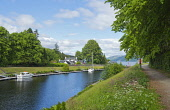 The Caledonian Canal at Fort Augustus, at the south west end of Loch Ness, Highlands of Scotland. Dennis Barnes / Scottish Viewpoi 2013,summer,sunny,village,water,engineering,attraction,visitor,visitors,tourist,tourists,tourism,tree,trees,tow,path,towpath,activity,activities,sailing,boat,boats,yacht,yachts