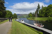The Caledonian Canal at Fort Augustus, at the south west end of Loch Ness, Highlands of Scotland. Dennis Barnes / Scottish Viewpoi 2013,summer,sunny,village,water,engineering,attraction,visitor,visitors,tourist,tourists,tourism,people,person,walk,walking,walker,walkers,couple,tree,trees,tow,path,towpath,activity,activities,sailin