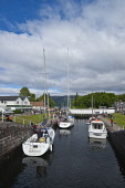 The Caledonian Canal at Fort Augustus, at the south west end of Loch Ness, Highlands of Scotland. Dennis Barnes / Scottish Viewpoi 2013,summer,sunny,village,water,engineering,attraction,visitor,visitors,tourist,tourists,tourism,tree,trees,tow,path,towpath,activity,activities,sailing,boat,boats,yacht,yachts,lock,locks