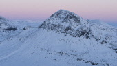 The view towards a snow covered Cul Beag from Sgorr Tuath at sunset, Highlands of Scotland. Nick McLaren / Scottish Viewpoin 2013,winter,Assynt,afterglow,ancient,atmosphere,atmospheric,beautiful,cliff,cliffs,dusk,cold,dramatic,scenery,evening,exposed,formation,formations,freezing,frost,frosted,frosty,frozen,ice,icy,isolated