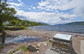 The beach and Loch Ness at Dores, Highlands of Scotland. Dennis Barnes / Scottish Viewpoi 2013,summer,sunny,attraction,visitor,tourist,tourism,water,hill,hills,mountain,mountains,Inn,pub,shingle,pebble,pebbles,information,board,sign,signs
