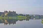The view across Linlithgow Loch to St Michael's Parish Church and Linlithgow Palace, Linlithgow, West Lothian. Dennis Barnes / Scottish Viewpoi 2013,summer,sunny,water,reflection,reflections,building,religion,attraction,visitor,tourist,history,heritage,historic,scotland,hs,activity,activities,sailing,boat,boats,dinghy,dinghies