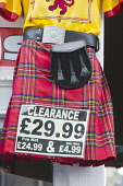 A cheap kilt for sale in a shop on the Royal Mile, in the city centre of Edinburgh. Dennis Barnes / Scottish Viewpoi 2013,summer,bargain,kitsch,clearance,sporran,tartan,red,tat,attraction,visitor,tourist,tourism,visitors,tourists