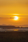 The silhouette of the Edinburgh skyline at sunset from Aberlady Bay, East Lothian. Andy Bennetts / Scottish Viewpoi 2009,autumn,sunny,atmospheric,dramatic,sunset,orb,sun,firth,forth,coast,coastal,coastline,water
