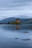 Looking over the calm waters of Loch Duich to Eilean Donan Castle, Highlands of Scotland. Andy Bennetts / Scottish Viewpoi 2010,summer,dusk,evening,atmospheric,dramatic,attraction,visitor,tourist,building,architecture,heritage,history,water,reflection,reflections
