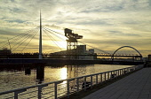 Looking east along the River Clyde at Pacific Quay to Bell's Bridge, the Finnieston Crane and the Clyde Arc (or Squinty Bridge) at sunrise, west of the city centre of Glasgow. Allan Wright / Scottish Viewpoin 2006,summer,atmospheric,silhouette,dawn,sun,rising,structure,engineering,water,reflection,reflections,bridges