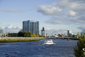 A pleasure boat on the River Clyde. Allan Wright / Scottish Viewpoin architecture,architectural,building,buildings,attraction,attractions,summer,sunny,no people,boats,finneston,crane,squinty,bridge