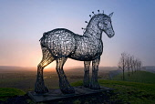 The Heavy Horse by Andy Scott, overlooks the M8 motorway in north east Glasgow, photographed at sunset. Allan Wright / Scottish Viewpoin 2008,winter,atmospheric,silhouette,public,art,artistic,artwork,arty,city,clydesdale,sculpture