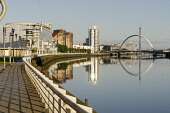 Looking west along the River Clyde towards the Clyde Arc (or Squinty Bridge), west of the city centre of Glasgow. Allan Wright / Scottish Viewpoin 2012,summer,sunny,sunshine,structure,engineering,water,reflection,reflections,bridges,calm,mirror,walkway,housing,flat,flats