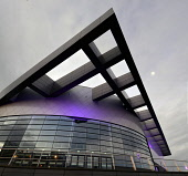 A detail of the Emirates Arena or Commonwealth Arena - built for the 2014 Commonwealth Games, Parkhead, east of the city centre of Glasgow. Allan Wright / Scottish Viewpoin 2013,autumn,building,architecture,scottish,exhibition,centre,conference,arena,concert,sec,ltd,limited,dusk,evening,light,lights,floodlit,floodlights,illuminated