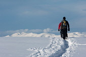 Walkers follow a path through snow on Aonach Mor, Highlands of Scotland. Kenny Ferguson / Scottish Viewpo 2010,winter,sunny,sunshine,activity,activities,walk,walking,walker,walkers,hill,hillwalker,hillwalkers,hillwalking,people,person,mountain,mountains,cold,track,tracks