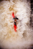 A kayaker plunging down the Lower Falls, in the River Nevis, Glen Nevis, Highlands of Scotland. Kenny Ferguson / Scottish Viewpo autumn,activity,activities,kayak,kayaks,kayaker,kayakers,paddle,paddling,sport,people,water,dramatic,extreme,splash,fall,plunge,plunging