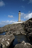 Looking up from the foreshore to the lighthouse at Ardnamurchan, Highlands of Scotland. Mark Hicken / Scottish Viewpoint summer,sunny,sunshine,coast,coastal,coastline,water,sea,rock,rocks,rocky,pool,pools,structure,engineering,building,architecture,light,house,peninsula