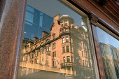 Buildings reflected in a window in the city centre of Glasgow. Ross Graham / Scottish Viewpoint spring,sunny,sunshine,architecture,architectural,building,buildings,office,offices,block,reflection,reflections,windows,glass