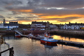 The harbour at Cromarty at sunrise, Black Isle, Highlands of Scotland. Ross Graham / Scottish Viewpoint winter,atmospheric,atmosphere,fisherman,fishermen,fishing,boat,boats,trawler,trawlers,industry,industries,pontoon,jetty,dawn,HDR