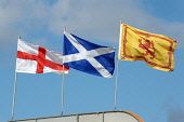 Flags fluttering in the breeze (L-R) St. George's Cross of England, the St. Andrews Cross of Scotland and the Lion Rampant of Scotland. Ross Graham / Scottish Viewpoint summer,sunny,flag,national,nationalism,devolution,politics,saltire
