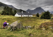 An artist paints the scene at Blackrock Cottage with Buachaille Etive Mor visible beyond, Highlands of Scotland. Ross Graham / Scottish Viewpoint summer,activity,activities,draw,drawing,painting,Rannoch,Moor,Glencoe,glen,coe,hill,hills,mountain,mountains,scenery,black,rock,person,people,HDR