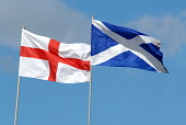 Flags fluttering in the breeze (L-R) St. George's Cross of England and the St. Andrews Cross of Scotland. Ross Graham / Scottish Viewpoint summer,sunny,flag,national,nationalism,devolution,politics,saltire