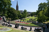 Graduating students and their families enjoying the sunshine in Union Terrace Gardens in the city centre of Aberdeen. Allan Wright / Scottish Viewpoin summer,sunny,sunshine,spire,spires,church,people,person,park,parks,recreation,bench,benches,student,study,graduation