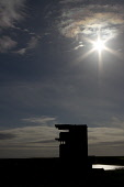 The wartime observation tower at Graemeshall Gun Battery silhouetted against the sky, Mainland, Orkney. 2013,summer,sunny,heritage,military,history,defence,old,disused,abandoned,relict,ruin,ruins,emplacement,Scapa,Flow,World,War,2,WW2,island,islands,isle,isles