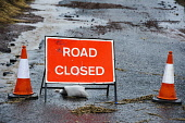 A sign indicating that a road is closed after flooding in South Lanarkshire. Andrew Wilson / Scottish Viewpoi 2013,winter,weather,extreme,flood,flooding,flooded,wet,rain,raining,cone,cones,traffic,signage,closures