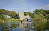 The small boat taking visitors over to Lochleven Castle, on Castle Island, Loch Leven, Kinross, Perthshire. Kenny Lam / Scottish Viewpoint 2013,autumn,autumnal,sunny,sunshine,people,person,visitors,visitor,attraction,attractions,history,heritage,historic,scotland,hs,ruin,ruins,ruined,mary,queen,scots,water