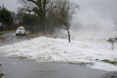 A tidal surge over a road, Dumfries and Galloway. Keith Kirk / Scottish Viewpoint 2014,winter,weather,extreme,flooding,flooded,wet,rain,raining,cloudy,water,dangerous,tide,wave,waves
