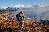 A hill fire near Banavie with a view beyond to Ben Nevis, Highlands of Scotland. Kenny Ferguson / Scottish Viewpo winter,sunny,sunshine,snow,control,danger,environment,flames,flame,grass,heat,heath,hill,hills,hillside,hot,moor,moorland,mountain,mountains,smoke,incident,people,person,firefighter,fireman,firefighte