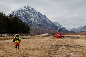 A Mountain Rescue team using a helicopter near the Kingshouse Hotel, at the east end of Glen Coe, Highlands of Scotland. Kenny Ferguson / Scottish Viewpo winter,mountains,transport,emergency,service,services,incident,people,person,aviation,buachaille,etive,mor,munro,snow,snowy,dusting,dusted