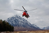A Mountain Rescue team using a helicopter near the Kingshouse Hotel, at the east end of Glen Coe, Highlands of Scotland. Kenny Ferguson / Scottish Viewpo winter,mountains,transport,emergency,service,services,incident,aviation,buachaille,etive,mor,munro,snow,snowy,dusting,dusted