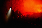 Firemen try to get a hill fire near Corpach under control, Highlands of Scotland. Kenny Ferguson / Scottish Viewpo winter,night,silhouette,control,danger,environment,flames,flame,grass,heat,heath,hot,moor,moorland,smoke,incident,people,person,firefighter,fireman,firefighters,firemen,atmospheric,atmosphere