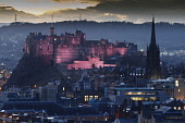 Looking over to Edinburgh Castle at dusk from Salisbury Crags, Edinburgh. Gary Doak / Scottish Viewpoint 2014,evening,floodlit,illuminated,city,cityscape,skyline,atmosphere,atmospheric,winter,attraction,attractions,visitor,tourist,history,heritage,historic,scotland,hs