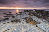 Sunrise over the Firth of Forth from the foreshore by Sauchope caravan park, Crail, East Neuk of Fife. Chris Lauder / Scottish Viewpoin 2012,summer,atmospheric,atmosphere,coast,coastal,coastline,water,sea,rock,rocks,foreshore,sky,bay,dawn,morning,serene,peaceful,calm,firth,forth,crail,east,neuk,fife