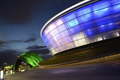 The SSE Hydro - a venue hosting national and international music stars and sporting events, with a view beyond to the Clyde Auditorium, Exhibition Way, west of the city centre of Glasgow. Chris Robson / Scottish Viewpoin 2013,architecture,architectural,building,buildings,sse,hydro,venue,night,dusk,evening,atmospheric,atmosphere,auditorium,light,lights,illuminated,arena,concert,conference,exhibition,centre,way