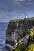Dunnet Head Lighthouse perched on dramatic cliffs of the Caithness coastline, Highlands of Scotland. Bill McKenzie / Scottish Viewpoi summer,sunny,sunshine,atmospheric,atmosphere,water,HDR,highlands,scotland,highland,caithness,coast,coastal,coastline,sea,cliff,fog,horn,foghorn,sheer