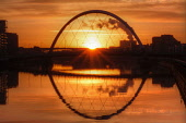 The Squinty Bridge / Clyde Arc over the River Clyde at sunrise, west of the city centre of Glasgow. Del Cowie / Scottish Viewpoint 2014,winter,atmospheric,atmosphere,dawn,morning,sun,rise,silhouette,water,reflection,reflections,engineering,structure