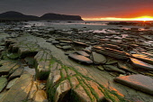 An Autumnal sunset from the rocky shore of Warebeth, West Mainland of Orkney with the Island of Hoy in the distance. Mark Ferguson / Scottish Viewpoi autumnal,autumn,sunset,coast,coastline,sea,water,rocky,shore,atmospheric,atmosphere,seascape,Atlantic,creative,moody,Warebeth,tranquil,peaceful,serene,ethereal,calm,Hoy,Orkney,island,islands,isle,isle