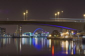 The view along the River Clyde under the Kingston Bridge towards the Clyde Arc (the Squinty Bridge) at night, west of the city centre of Glasgow. Allan Wright / Scottish Viewpoin 2013,glasgow,city,strathclyde,scotland,scottish,urban,night,lights,streetlights,architecture,architectural,building,buildings,structure,engineering,bridge,squinty,arc,kingston,reflection,reflections,w