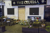 Floral tributes outside the Clutha Vaults after a police helicopter crashed into the pub on November 29th, killing ten people, east of the city centre of Glasgow. Allan Wright / Scottish Viewpoin 2013,glasgow,city,strathclyde,scotland,scottish,floral,tributes,tribute,Clutha,Vaults,police,helicopter,crash,crashed,pub,bar,public,house,November,29th,accident,flowers