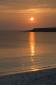 Sunset at the Bay of Skaill, Mainland, Orkney. Picture Credit : Iain Sarjeant / Scottish Viewpoint  Tel: +44 (0) 131 622 7174  E-Mail : info@scottishviewpoint.com  Web: www.scottishviewpoint.com This... 2012,island,islands,isle,isles,summer,coast,coastal,coastline,atmospheric,dramatic,silhouette,orb,reflection,beach,water