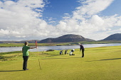Stromness Golf Course with a view beyond to the Island of Hoy, Mainland, Orkney. Picture Credit : Iain Sarjeant / Scottish Viewpoint  Tel: +44 (0) 131 622 7174  E-Mail : info@scottishviewpoint.com  We... 2012,summer,sunny,island,islands,isle,isles,activity,activities,golf,golfer,golfers,golfing,sport,sports,people,person,couple,two,lady,ladies,green,hole,putt,flag,club,links,coast,coastal,coastline,wa