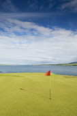 Stromness Golf Course, Mainland, Orkney. Picture Credit : Iain Sarjeant / Scottish Viewpoint  Tel: +44 (0) 131 622 7174  E-Mail : info@scottishviewpoint.com  Web: www.scottishviewpoint.com This photog... 2012,summer,sunny,island,islands,isle,isles,activity,activities,golf,golfing,sport,sports,green,hole,flag,club,links,coast,coastal,coastline,water,sea