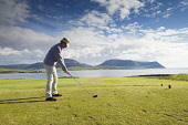 Stromness Golf Course with a view beyond to the Island of Hoy, Mainland, Orkney. Picture Credit : Iain Sarjeant / Scottish Viewpoint  Tel: +44 (0) 131 622 7174  E-Mail : info@scottishviewpoint.com  We... 2012,summer,sunny,island,islands,isle,isles,activity,activities,golf,golfer,golfers,golfing,sport,sports,people,person,lady,teeing,off