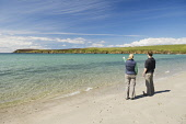 A couple walking on Sands of Wright, South Ronaldsay, Orkney. Picture Credit : Iain Sarjeant / Scottish Viewpoint  Tel: +44 (0) 131 622 7174  E-Mail : info@scottishviewpoint.com  Web: www.scottishview... 2012,summer,sunny,island,islands,isle,isles,people,person,beach,sand,sandy,white,romantic,activity,activities,walk,walking,walker,walkers,coast,coastal,coastline,water,sea