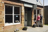 A couple visit the Workshop and Loft Gallery, St Margaret's Hope, South Ronaldsay, Orkney. Picture Credit : Iain Sarjeant / Scottish Viewpoint  Tel: +44 (0) 131 622 7174  E-Mail : info@scottishviewpoi... 2012,summer,sunny,art,arts,craft,crafts,island,islands,isle,isles,attraction,visitor,visitors,tourist,tourists,tourism,people,person,retail,shop,shopping,shops,shopper,shoppers