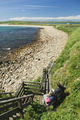 A couple sit by the beach at Dingieshowe, Mainland, Orkney. Picture Credit : Iain Sarjeant / Scottish Viewpoint  Tel: +44 (0) 131 622 7174  E-Mail : info@scottishviewpoint.com  Web: www.scottishviewpo... 2012,summer,sunny,island,islands,isle,isles,people,person,beach,sand,sandy,white,romantic,activity,activities,walk,walking,walker,walkers,coast,coastal,coastline,water,sea,deerness