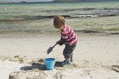 A child on the beach at Newark Bay, Mainland, Orkney. Picture Credit : Iain Sarjeant / Scottish Viewpoint  Tel: +44 (0) 131 622 7174  E-Mail : info@scottishviewpoint.com  Web: www.scottishviewpoint.co... 2012,summer,sunny,island,islands,isle,isles,activity,activities,people,person,beach,sand,sandy,white,child,children,kid,kids,family,families,sandcastle,sandcastles,bucket,spade,play,playing