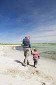 A mother and son on the beach at Newark Bay, Mainland, Orkney. Picture Credit : Iain Sarjeant / Scottish Viewpoint  Tel: +44 (0) 131 622 7174  E-Mail : info@scottishviewpoint.com  Web: www.scottishvie... 2012,summer,sunny,island,islands,isle,isles,activity,activities,people,person,beach,sand,sandy,white,child,children,kid,kids,family,families,play,playing,mum